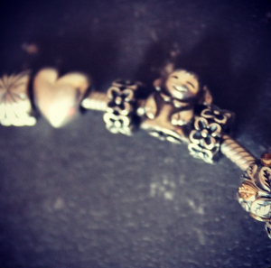 The two Forget-Me-Nots spacers on my Pandora Bracelet, memorials to the two lost babies.